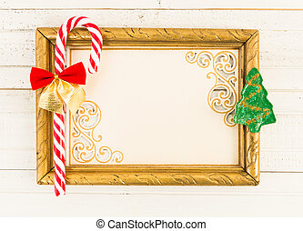 Christmas concept with empty picture frame and cane candy