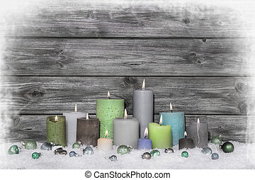 Christmas congratulatory card with many candles on wooden grey s