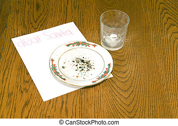 Christmas Cookie Crumbs and Empty Milk Glass on Table - ...