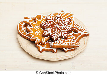 Christmas Cookie on White Wooden Background. Gingerbread, a traditional Scandinavian Christmas Food