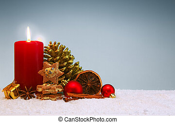 Christmas cookies and red advent candle isolated on gray.