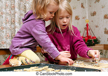 Christmas cookies - Children making christmas cookies in the...