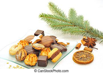Christmas cookies on a glass plate.