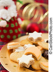 Christmas cookies on golden plate with festive decoration