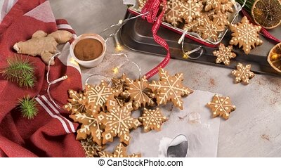 Christmas cookies on kitchen countertop with festive decorations.