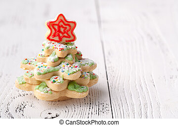 Christmas cookies on wooden table with copy cpace