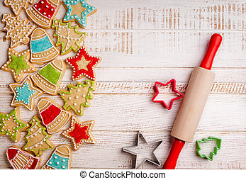 Christmas cookies, rolling pin and cookie cutters on the ...