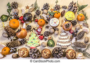 Christmas cookies, Santa Claus,fruits,nuts, pine cones with chocolate sweets