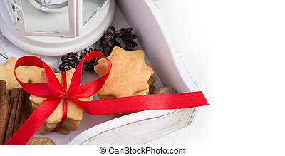 Christmas cookies tied with red ribbon in a wooden box. Space fo