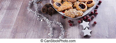 Christmas cookies with decoration on wooden table