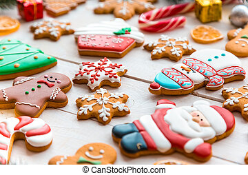 Christmas cookies with festive branches fir. Homemade delicious Christmas gingerbread on the white wooden background