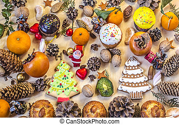 Christmas cookies,fruits, Santa Claus, nuts, pine cones with chocolate sweets