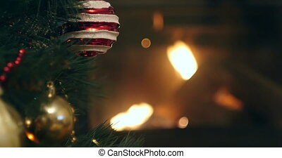 details of christmas decorations with burning fireplace in the background