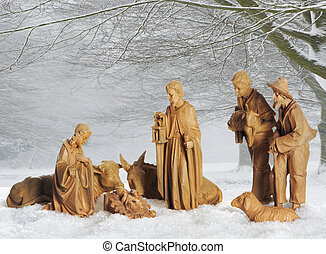 Christmas crib - Old christmas manger against a snowy...