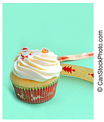Christmas Cupcake on green background. close up.
