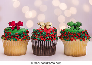 Christmas Cupcakes - Three vanilla and chocolate christmas...