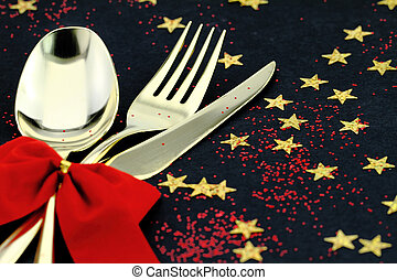 Christmas cutlery. Spoon, fork and knife stacked up on a ...
