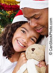 christmas daughter hugging daddy