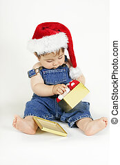 Christmas day - Baby girl in a denim bib and brace and red...