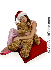Christmas Day Dreaming - Teen girl day dreaming. Sitting in...