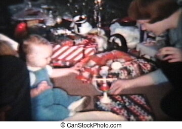 Christmas Day Fun (1963 Vintage) - A cute baby boy plays...
