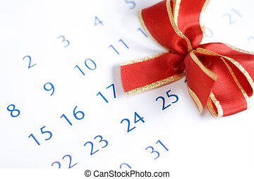 Christmas day concept: calendar with red bow above december...