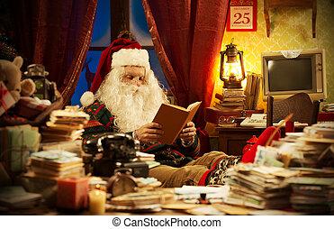 Christmas Day - Santa Claus reading a book at home
