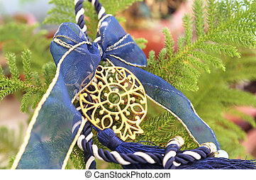 decorative Christmas pomegranate with blue ribbons