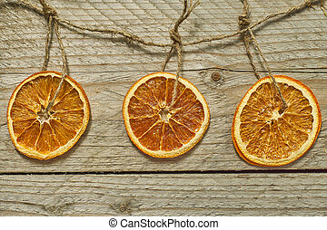 Christmas decor. dried orange slices for new year tree decoration on wooden background