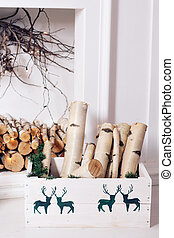 Christmas decor. Stack of firewood ready for the fireplace divided in boxes