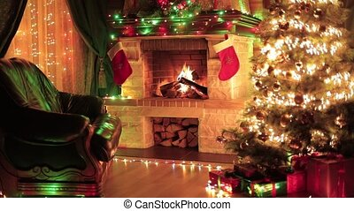 Christmas decorated interior with fireplace, armchair, ...