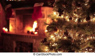 Christmas decorated tree closeup with fireplace living room ...