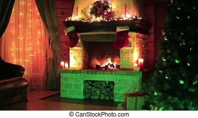 Christmas decorated tree interior with fireplace and ...