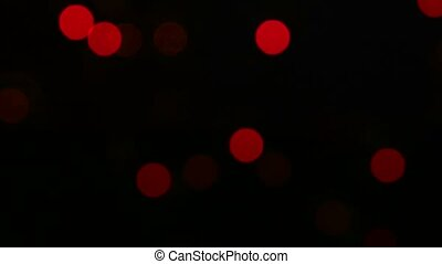 Christmas decoration - a crystalline brown toy on tree, bokeh, light, black, garland, cam moves to the right