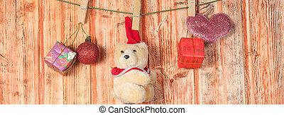 Christmas decoration and bear toy on wood