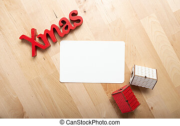 christmas decoration and christmas card on the table