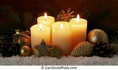 Christmas decoration and four burning Advent candles. -...