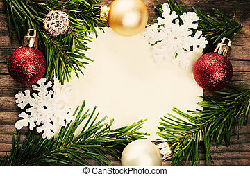 Christmas Decoration and Green Fir Branch on Blank Paper and Wooden. New Year Background