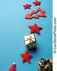 Christmas decoration as frame on a blue paper background