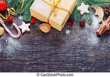 Christmas decoration background over dark wooden background, top view. Horizontal photo of decorations taken from above with copy space for text
