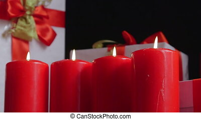 Christmas decoration background with gifts boxes and four burning candles