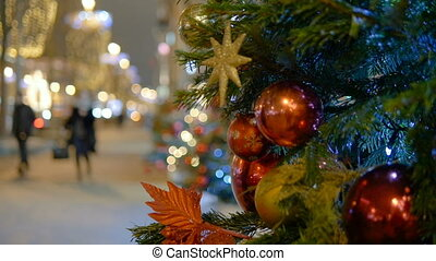 Christmas decoration balls hanging on tree on the background lights garland