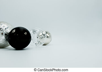 Christmas decoration balls in black, white, silver and transparent.