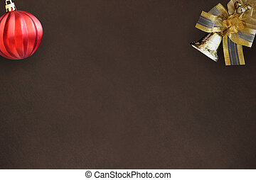 Christmas decoration bell with a bow and red wavy ball on a dark background