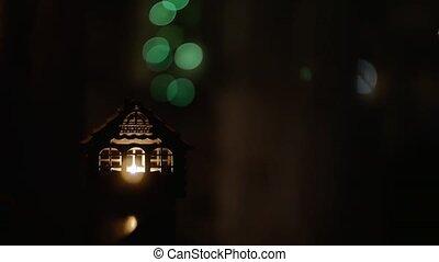 Christmas Decoration. Burning candle on blinking lights background