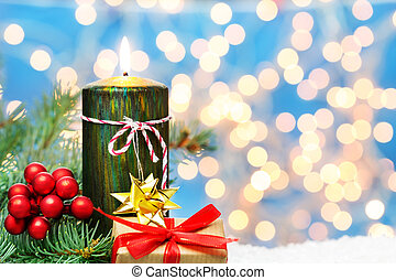 Christmas decoration, candle and gift in the snow