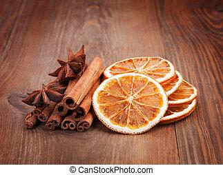 Christmas decoration - dried orange, cinnamon sticks, cloves on