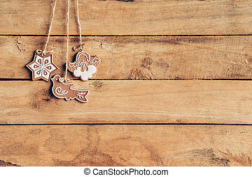 Christmas decoration hanging on wood background texture with copy space.