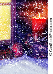 Christmas decoration in front of the window in the snow