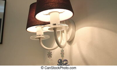 Christmas decoration in the form of bells on lamp